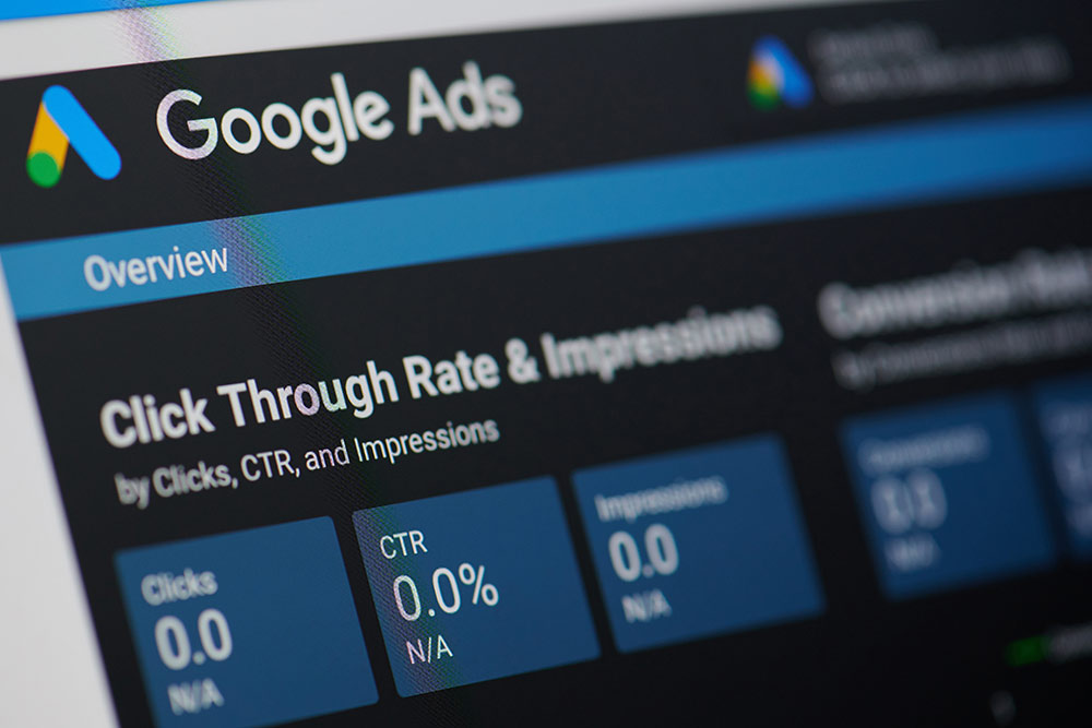 Laptop screen on google ads showing click through rate insights for ad